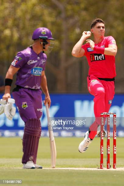 Sean Abbott of the Sydney Sixers bowls during the Big Bash League match between the Hobart Hurricanes and the Sydney Sixers at Traeger Park on...