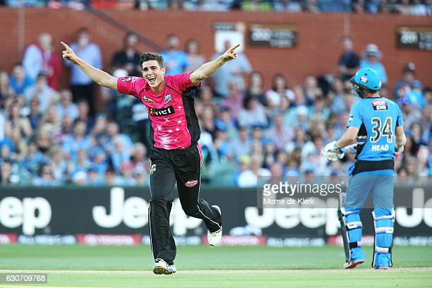 Sean Abbott of the Sydney Sixers celebrates after getting the wicket of Travis Head of the Adelaide Strikers during the Big Bash League match between...