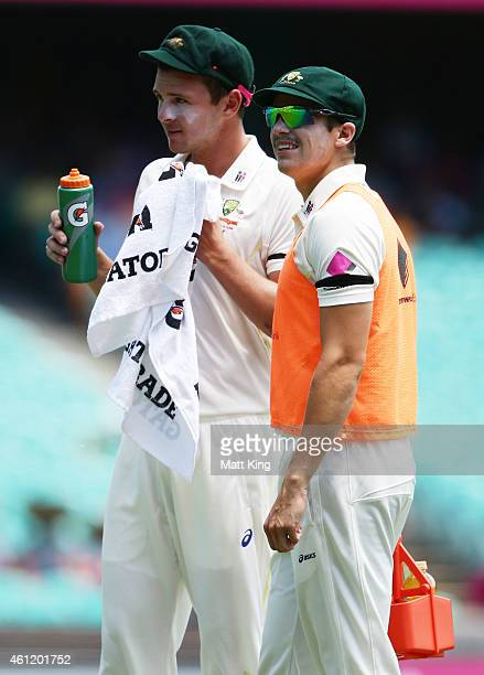 Sean Abbott runs drinks to Josh Hazlewood of Australia during day four of the Fourth Test match between Australia and India at Sydney Cricket Ground...