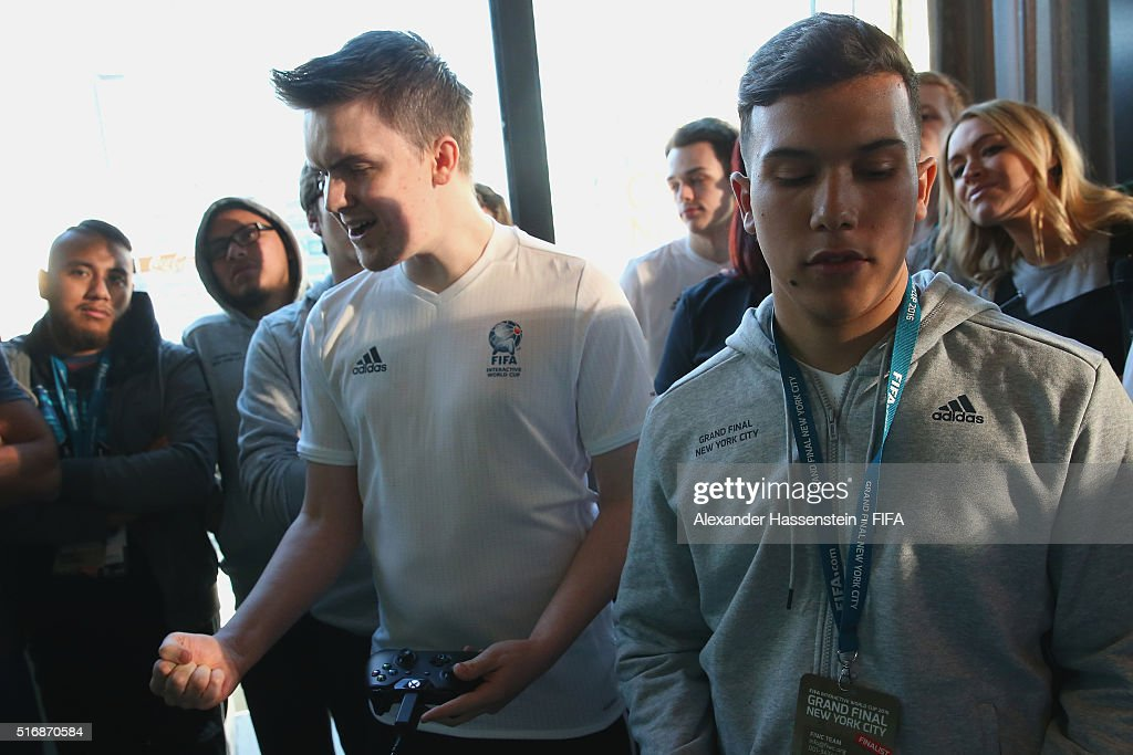Sean Allan of England plays with Rodrigo Araujo (R) of Brazil during the quarter finale for the FIFA Interactive World Cup 2016 at The Skylark lounge New York downtown Manhattan on March 21, 2016 in New York City.