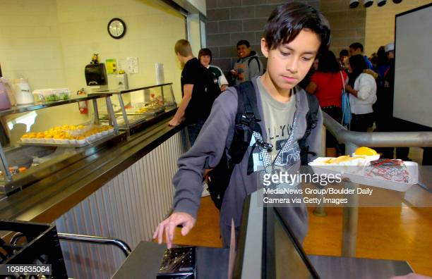 Sean Allen 9th grader punches in his identification code to pay for his lunch at Erie High School on Thursday October 28 2010 in Boulder