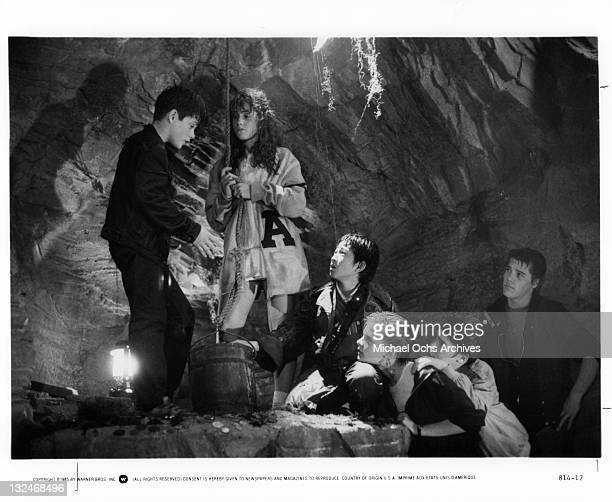 Sean Astin And Kerri Green with others talk in a cave in a scene from the film 'Goonies' 1985 Also pictured are Ke Huy Quan Martha Plimpton Corey...