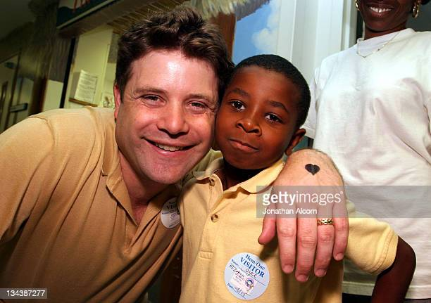 Sean Astin shares a laugh with Collin Ramsey a 7 year old who's sister Camarah is a patient during visit by celebrities at Miller Children's Hospital...