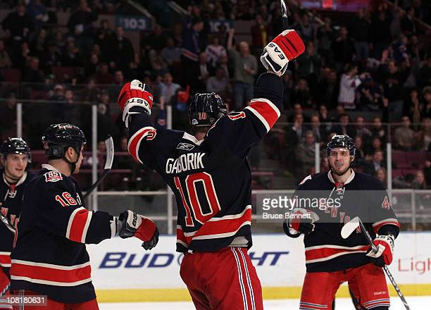 Sean Avery of the New York Rangers and Steve Eminger help Marian Gaborik celebrate his hat trick goal against the Toronto Maple Leafs at Madison...