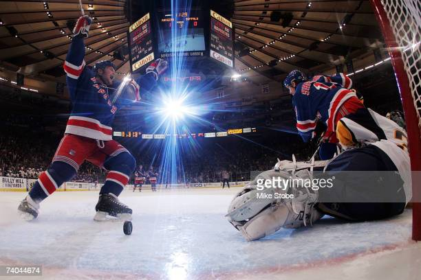 Sean Avery of the New York Rangers celebrates the goal of Brendan Shanahan in the third period against Ryan Miller of the Buffalo Sabres during Game...