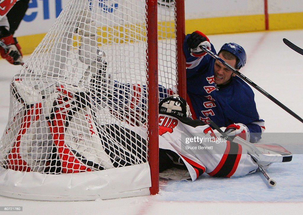 Sean Avery Of The New York Rangers Crashes Into Martin Brodeur Of