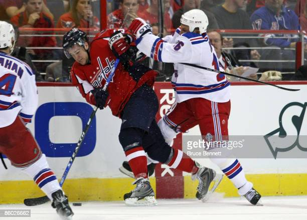 Sean Avery of the New York Rangers hits Mike Green of the Washington Capitals during Game Two of the Eastern Conference Quarterfinal Round of the...