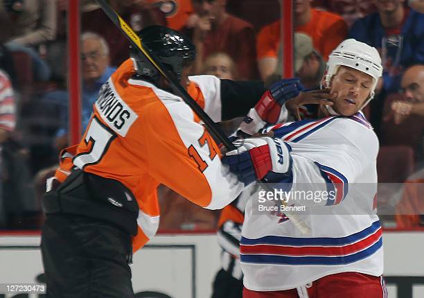 Sean Avery of the New York Rangers is hit by Wayne Simmonds of the Philadelphia Flyers during an NHL preseason game at Wells Fargo Center on...