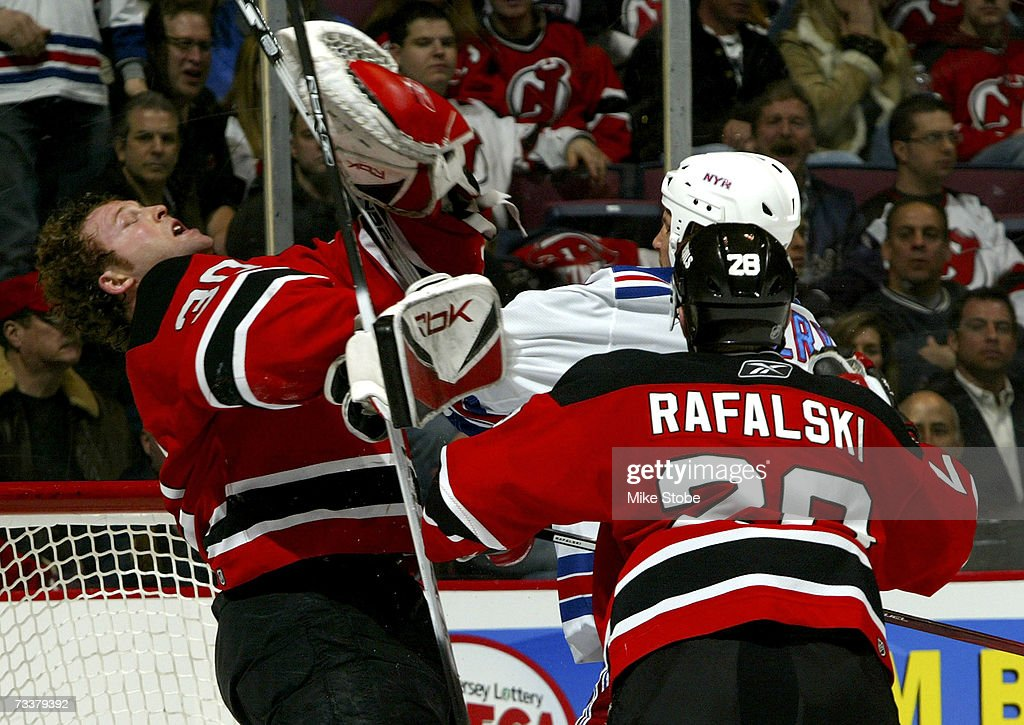 Sean Avery Of The New York Rangers Punches Goaltender Martin Brodeur