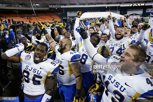 Sean Bacon and Travis Johnson of the San Jose State Spartans celebrate after defeating the Bowling Green Falcons 2920 to win the Military Bowl at RFK...