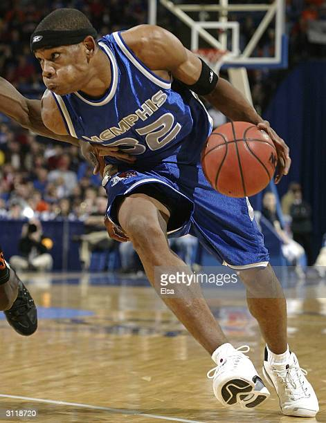 Sean Banks of the Memphis Tigers drives toward the net in the first half against the Oklahoma State Cowboys during the second round of the NCAA...