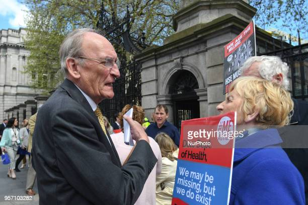 Sean Barrett an Irish Fine Gael politician chats with campaigners for #MillionsMissing a movement to raise awareness for ME an underfunded and...