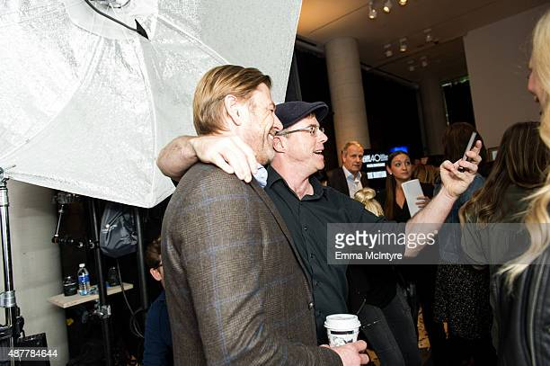 Sean Bean and writer Andy Weir of 'The Martian' attends the Guess Portrait Studio at the Toronto International Film Festival on September 11 2015 in...