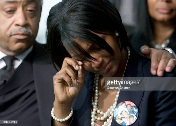 Sean Bell's fiance Nicole PaultreBell is comforted by Rev Al Sharpton as they watch Queens District Attorney Richard Brown on television unseal the...