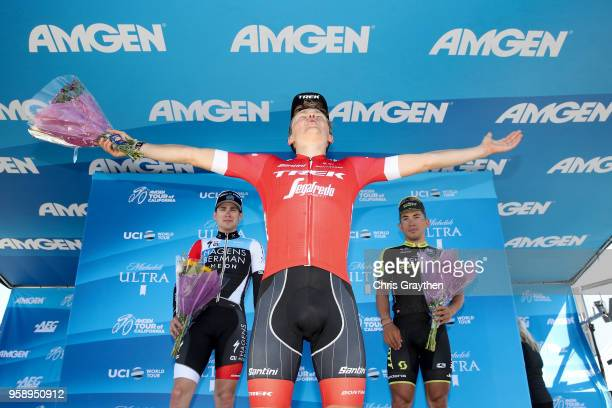 Sean Bennett of The United States and Team Hagens Berman Axeon in second place, stage winner Toms Skujins of Latvia and Team Trek Segafredo and third...