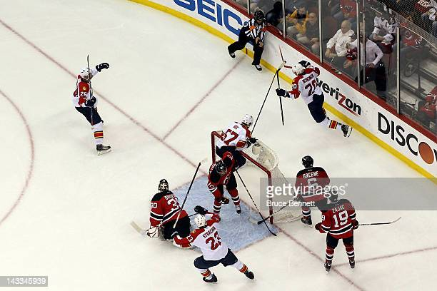 Sean Bergenheim of the Florida Panthers celebrates behind the net with his teammates after he tied the game 22 on a secon dperiof goal against goalie...
