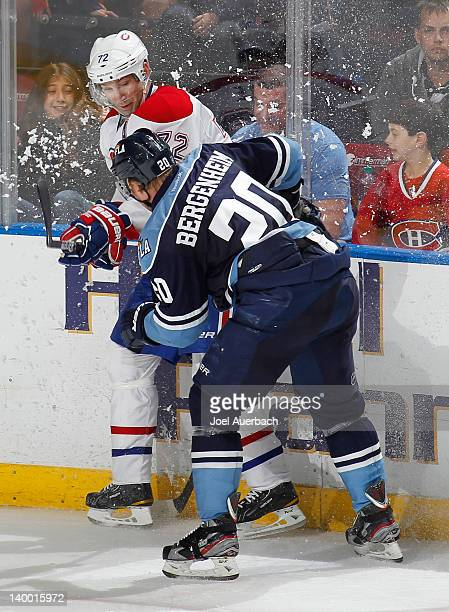 Sean Bergenheim of the Florida Panthers checks Erik Cole of the Montreal Canadiens on February 26, 2012 at the BankAtlantic Center in Sunrise,...