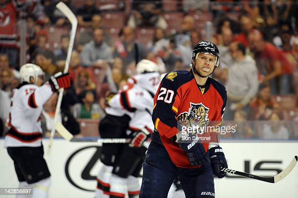 Sean Bergenheim of the Florida Panthers skates off the ice as the New Jersey Devils celebrate a 10 lead in the first period in Game 1 of the Eastern...