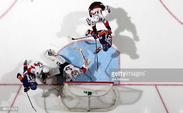 Sean Bergenheim of the New York Islanders scores a third period goal past Brian Elliott of the Ottawa Senators on April 3, 2010 at Nassau Coliseum in...
