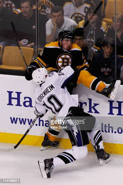 Sean Bergenheim of the Tampa Bay Lightning checks Brad Marchand of the Boston Bruins in Game One of the Eastern Conference Finals during the 2011 NHL...