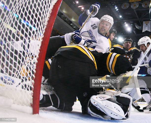 Sean Bergenheim of the Tampa Bay Lightning falls on Tim Thomas of the Boston Bruins in Game Two of the Eastern Conference Finals during the 2011 NHL...
