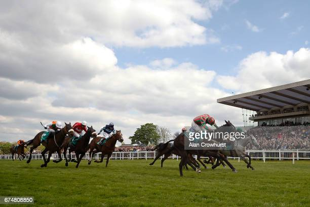 Sean Bowen riding Henllan Harri clear the last to win The bet365 Gold Cup Handicap Steeple Chase at Sandown Park on April 29 2017 in Esher England
