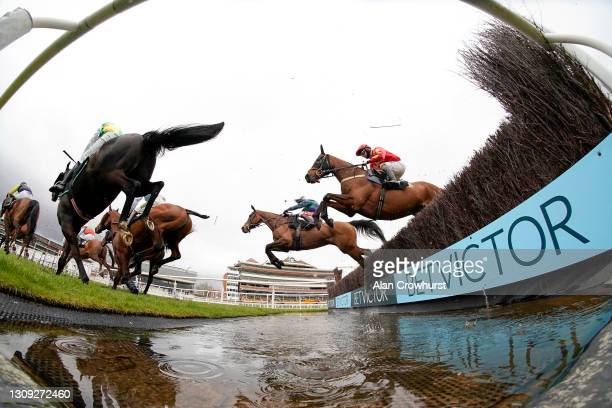 Sean Bowen riding Mac Tottie clear the water jump on their way to winning The BetVictor Novices' Limited Handicap Chase at Newbury Racecourse on...