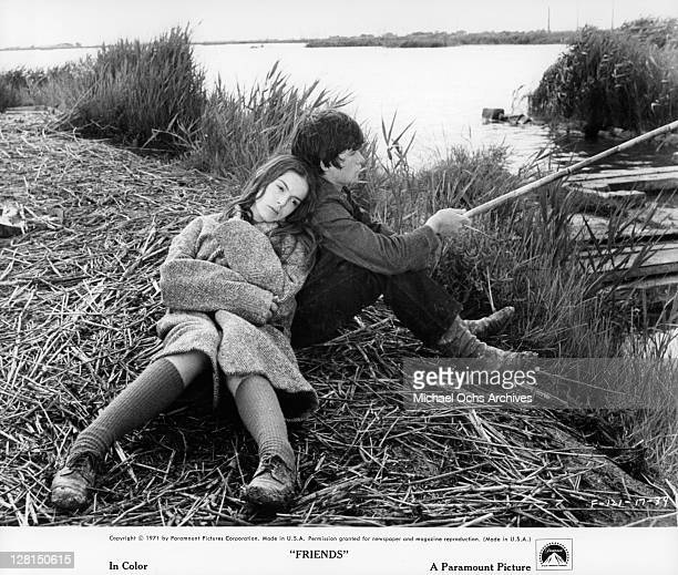 Sean Bury and Anicee Alvina await the birth of a child near their cottage in a scene from the film 'Friends' 1971