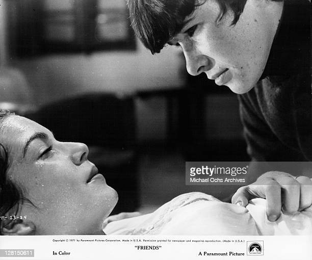 Sean Bury is looking at Anicee Alvina while her eyes are closed in a scene from the film 'Friends' 1971