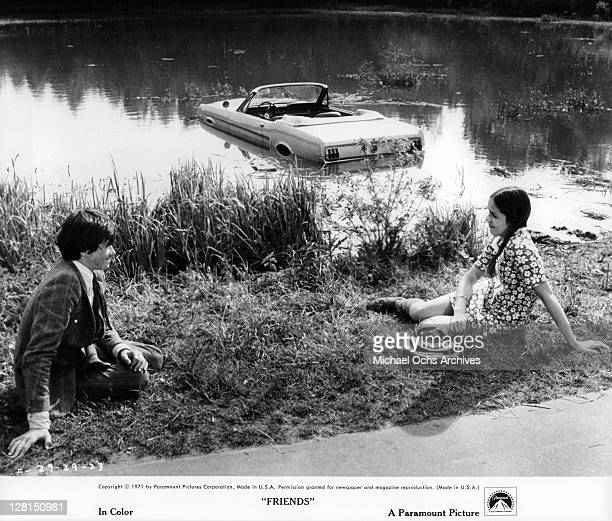 Sean Bury is on top of Anicee Alvina sink the car in a lake in a scene from the film 'Friends' 1971
