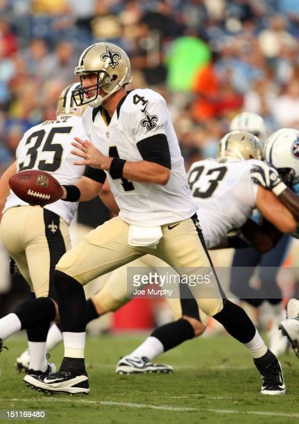 Sean Canfield of the New Orleans Saints looks to hand off the ball against the Tennessee Titans at LP Field on August 30 2012 in Nashville Tennessee