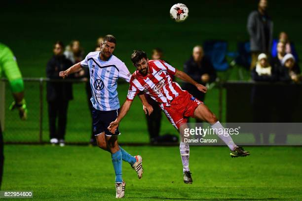Sean Canham of Sorrento FC competes for the ball deep in attack against Josh Calabria of Canberra Olympic FC during the FFA Cup round of 32 match...