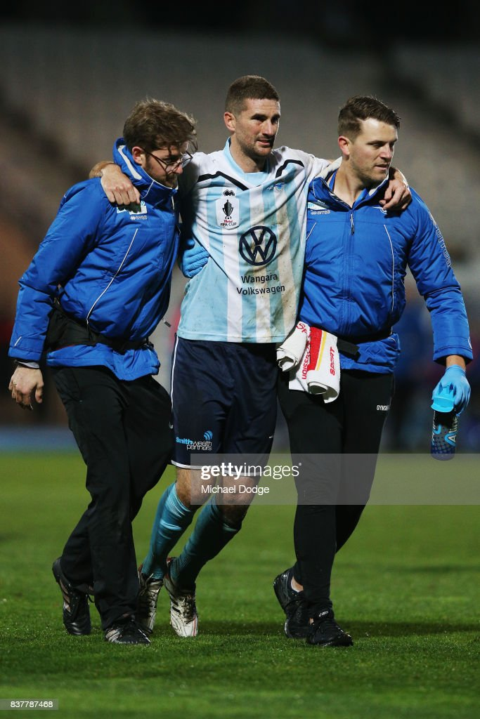 Sean Canham of Sorrento is carried off after receiving a red card during the FFA Cup round of 16 match between between South Melbourne FC and Sorrento FC at Lakeside Stadium on August 23, 2017 in Melbourne, Australia.