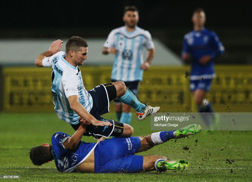 Sean Canham of Sorrento is tackled by Kristian Konstantinidis of South Melbourne during the FFA Cup round of 16 match between between South Melbourne FC and Sorrento FC at Lakeside Stadium on August 23, 2017 in Melbourne, Australia.