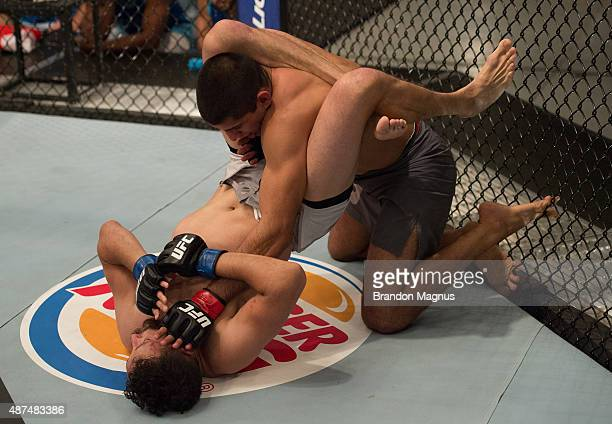 Sean Carter attempts to submit Sascha Sharma during the elimination fights at the UFC TUF Gym on July 17 2015 in Las Vegas Nevada