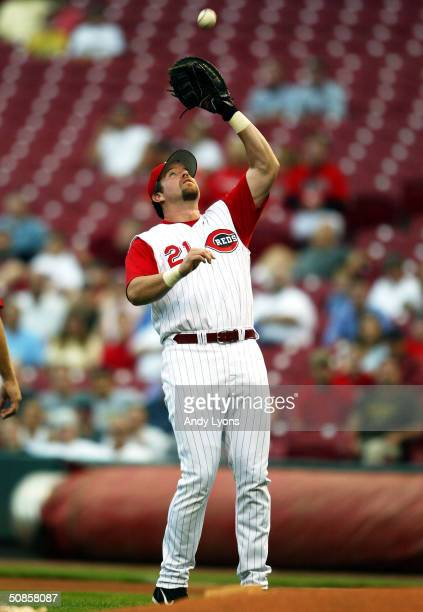 Sean Casey of the Cincinnati Reds catches a pop fly hit by Luis Gonzalez of the Colorado Rockies on May 19 2004 at Great American Ballpark in...