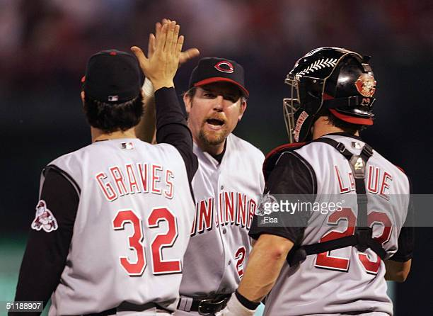 Sean Casey of the Cincinnati Reds celebrates with teammates Jason LaRue and Danny Graves after they defeated the St Louis Cardinals on August 18 2004...