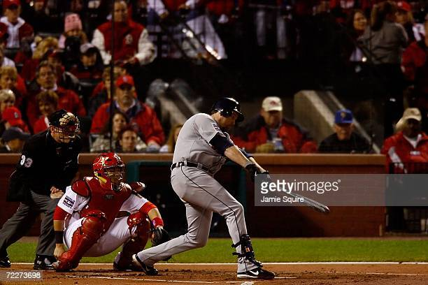 Sean Casey of the Detroit Tigers hits a solo home run in the second inning against starting pitcher Jeff Suppan of the St Louis Cardinals during Game...