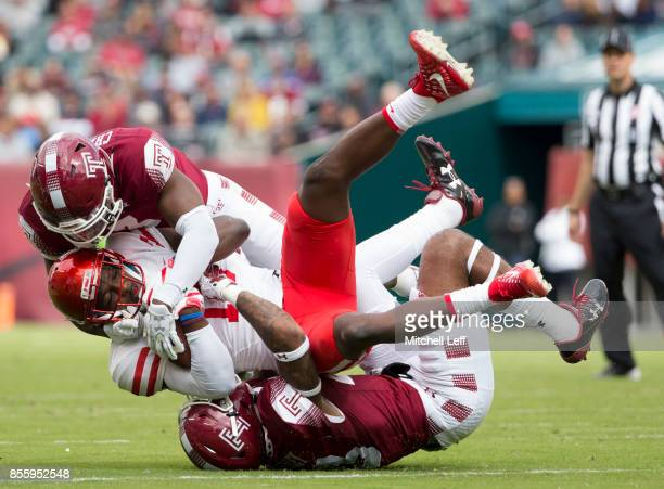 Sean Chandler and Shaun Bradley of the Temple Owls tackle Linell Bonner of the Houston Cougars in the first quarter at Lincoln Financial Field on...