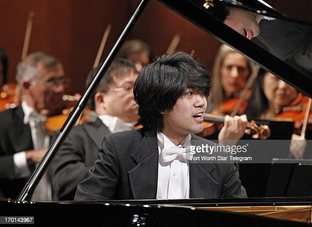 Sean Chen of the United States plays a concerto with the Fort Worth Symphony Orchestra on the second day of finals in the 14th Van Cliburn...