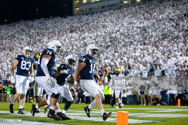 Sean Clifford of the Penn State Nittany Lions celebrates a touchdown run during the second quarter against the Michigan Wolverines on October 19 2019...