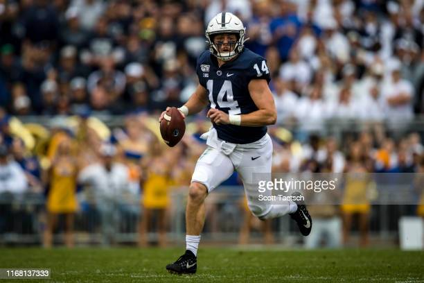 Sean Clifford of the Penn State Nittany Lions scrambles against the Pittsburgh Panthers during the first half at Beaver Stadium on September 14 2019...