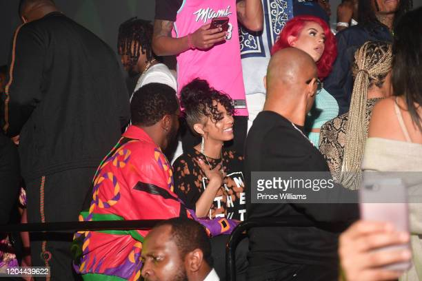 Sean Combs and Christina Mackey attend the Million Dollar Bowl at The Dome Miami on February 3 2020 in Miami Florida