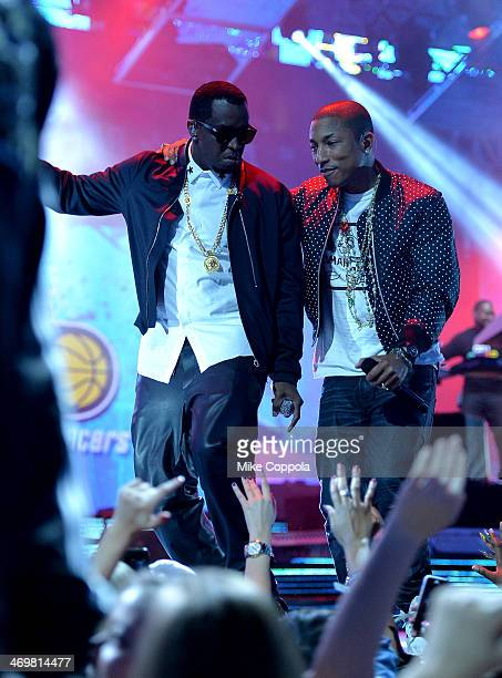 Sean Combs and Pharrell Williams perform onstage at the 63rd NBA AllStar Game 2014 at the Smoothie King Center on February 16 2014 in New Orleans...
