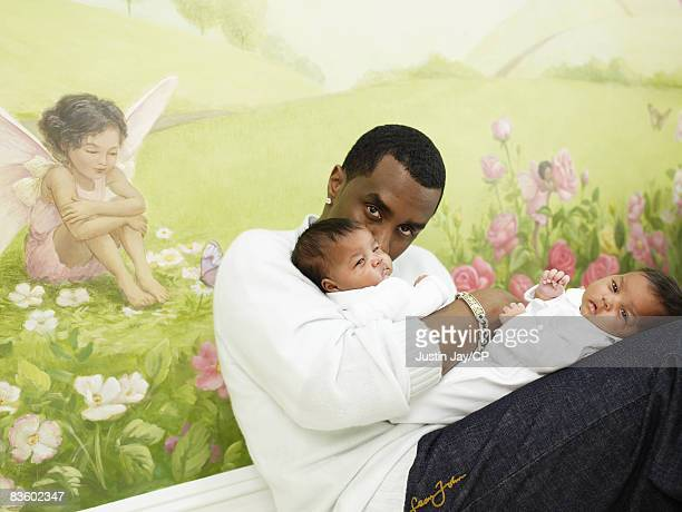 Sean Combs at home in New Jersey with twin baby daughters D'Lila Star and Jessie James on January 24 2007Credits Make up Merrell Hollis/Ken Barboza...