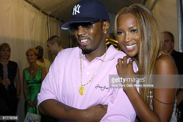 Sean Combs gets a hug from supermodel Naomi Campbell backstage during the Fashion for Relief runway show at the tents in Bryant Park on the last day...