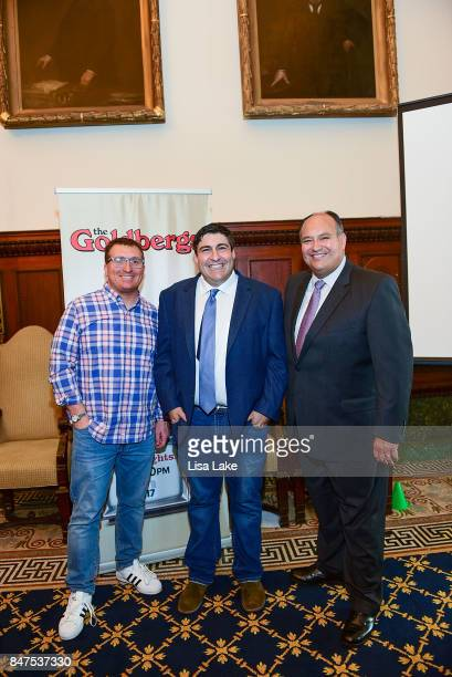 Sean Compton and Vince Giannini pose with Producer Adam F Goldberg during an event honoring Goldberg at Philadelphia City Hall on September 15 2017...