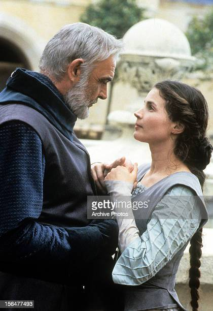 Sean Connery and Julia Ormond looking into each other's eyes in a scene from the film 'First Knight', 1995.