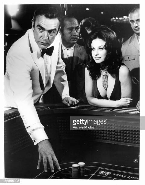 Sean Connery and Lana Wood at the gambling table in a scene from the film 'James Bond Diamonds Are Forever' 1971