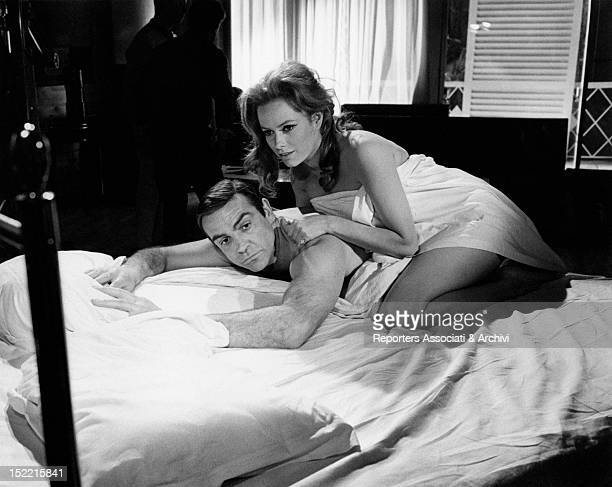 Sean Connery and Luciana Paluzzi are in bed in a scene from Thunderball, fourth episode of James Bond's series. London, March 1965.